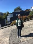 Wendy attempting to show the pitch of the road: Baldwin Street, Dunedin